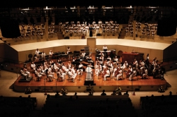 The Buffalo Philharmonic Chorus and Chautauqua Symphony Orchestra, under the direction of guest conductor Doreen Rao, perform selections from Britten, Bach and Bernstein Saturday evening in the Amphitheater. Photo by Megan Tan.