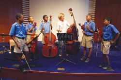 Caitlyn Kamminga works with a group of string students in Trinidad and Tobago. Submitted photo.