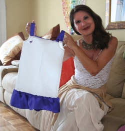 Nancy Hahn holds a dress featuring Purple Frog, one of the characters she created. Submitted photo.
