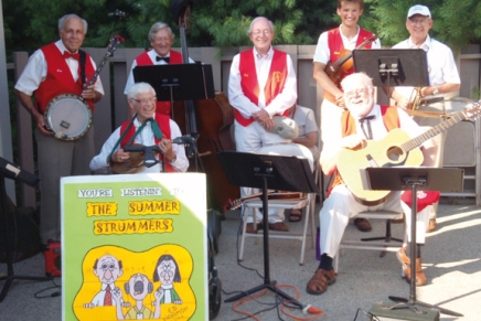 Summer Strummers spread summer cheer with folk sing-along