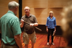 "Ned Jamison (Hugh Butler), center left, confronts Harry Washington (Carl Badger), left, as Kathy Jamison (Margaret Johnson), center right, and Miss Collins (Mary Lee Talbot), right, look on during a rehearsal of David Zinman's play ""What's in a Name?"" in Fletcher Music Hall. Photo by Ellie Haugsby."