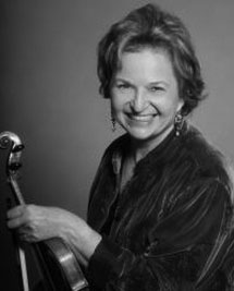 In guest teaching violin students, Vamos offers respectfulcritiques