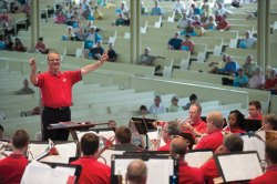 Keith M. Wilkinson, musical director of the Brass Band of the Western Reserve, conducts the band during its Amphitheater performance last season. Daily file photo.