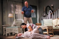 After Nina (Vivienne Benesch) ingests a sleeping pill, she fights to stay asleep in Chautauqua Theater Company's production of Kate Fodor's Fifty Ways. Zoe (Leah Anderson) attempts to rouse her, while Nina's husband, Adam (Michael Gaston), tries to help.  Photo by Eric Shea.