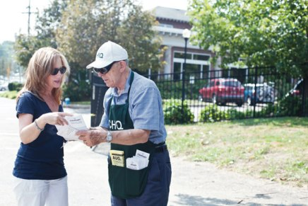 Volunteers help visitors find their way