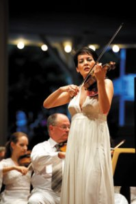 Guest soloist Anne Akiko Meyers performs Mendelssohn's Violin Concerto in E Minor with the Chautauqua Symphony Orchestra and guest conductor Andrew Litton Thursday evening in the Amp. Photo by Eric Shea.