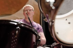 Tim Bartlett, 16, from Cassadaga, N.Y., plays drums at rehearsal. Bartlett also plays guitar. Photo by Adam Birkan.