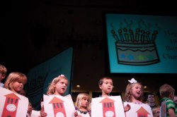 "Students from Children's School sing ""Happy Birthday"" to mark Chautauqua Institution's 137th birthday during last season's Old First Night exercises. Daily file photo."