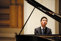 "Kevin Wu plays Étude No. 1, ""Pour les cinq doigts,"" by Claude Debussy, during the first round of the Chautauqua Piano Competition last weekend in Elizabeth S. Lenna Hall. Photo by Eric Shea."