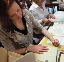 Oliver Archives Center assistant Amanda Holt reads and organizes the Miller Family Papers before the collection is sent to Rutgers University to become part of the Thomas A. Edison Papers Project. Photo by Michelle Kanaar.