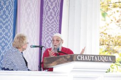 Rabbi Arthur Waskow speaks with the Rev. Joan Brown Campbell, director of Chautauqua's Department of Religion, about social issues Friday afternoon in the Hall of Philosophy. Waskow insists that every generation has to struggle for freedom from oppressors. Photo by Eric Shea.