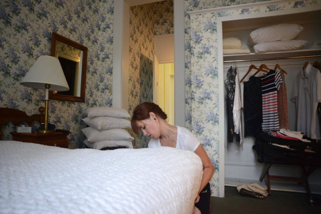 A housekeeper prepares the room for the incoming guests at the Athenaeum Hotel on June 12, 2014 before the official opening of the summer season at Chautauqua Institution in Chautauqua, NY. The Athenaeum Hotel built in 1881 is one of the Institution's landmarks, also considered to be a prestigious place to work for because of its history and historical figures who have stayed at the hotel, like Thomas Jefferson, president Clinton, and Franklin D. Roosevelt.