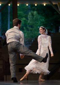 "North Carolina Dance Theatre's Gregory DeArmond and Anna Gerberich perform to the music of the Chautauqua Symphony Orchestra Tuesday evening in the Amphitheater. The pair portrayed the bride and groom in ""Appalachian Suite,"" composed by Grant Cooper and choreographed by Mark Diamond. (1)"