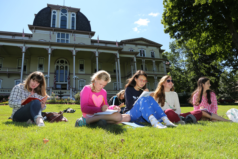 Brian Smith   Staff PhotographerStudents in the Chautauqua Youth Writing Camp sit in front of the Athenaeum Hotel on Wednesday. The young writers explored the Chautauqua grounds, learning about different forms of writing throughout their week in camp.