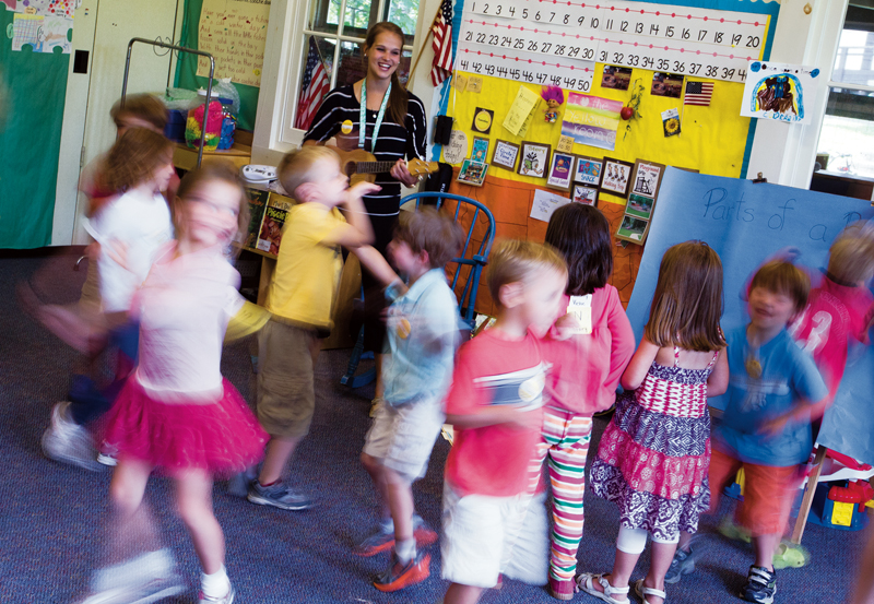 Greg Funka | Staff PhotographerLaura Giberson leads the five year-olds of the Yellow Room as they practice their song and dance routine for Open House Friday, August 2.