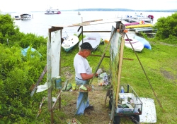 Stanley Lewis, visiting artist at the Chautauqua School of Art, works on an oil painting of Chautauqua Lake, which he's worked on for three weeks, near University Beach on North Lake Drive Wednesday afternoon.