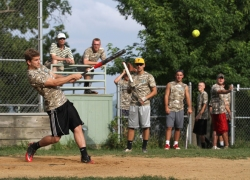 The Cops' Cody Fuller makes solid contact against the Slugs during the Chautauqua men's softball championship game Aug. 7 at Sharpe Field. The Cops beat the Slugs, 19-15. (1)