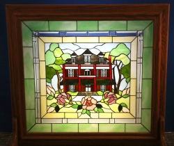 A window that hangs in front of the fireplace of the Presbyterian House. (4)