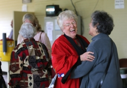 The Rev. Joan Brown Campbell laughs with a parishioner on the back porch of the Amphitheater after the conclusion of Sunday's morning worship service.