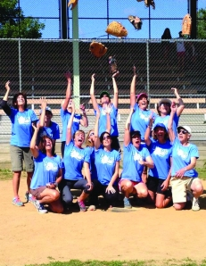 photo courtesy of John CHubbMembers of The MOMS celebrate another softball championship at Sharpe Field on Sunday, Aug. 4.