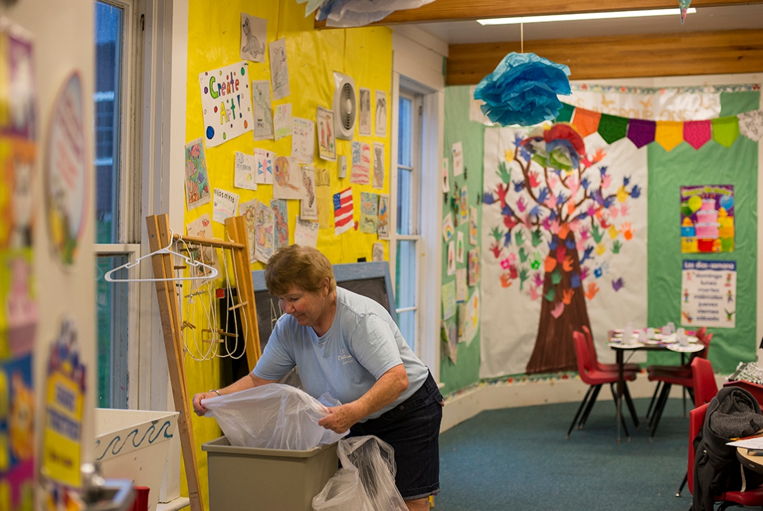 Sarann Rotunda cleans the classrooms in Sheldon Hall of Education at 8:30 a.m. every morning in preparation for Children's School beginning at 9 a.m. Photo by Rachael Le Goubin.