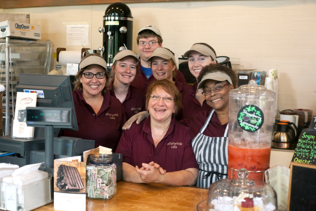 Anne Eklund (middle) has been the manager at the Afterwords Café since it opened eight years ago. She is pictured with part of her team of workers. Photo by Kreable Young.