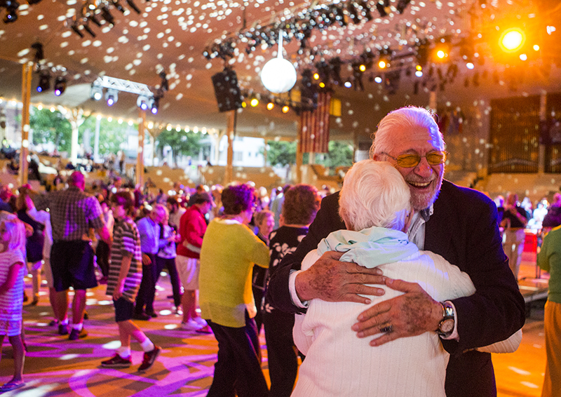 Sy Amkraut embraces Bernette Rudolph on the dance floor during the Amphitheater Ball. (Photo by Ruby Wallau)