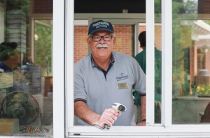 Dave Howard, who mans the Main Gate, has been working seasonally at the Institution since 1999. Khimean Casey is now in his second year as a bell captain at the Athenaeum Hotel. (Saalik Khan — Staff Photographer)