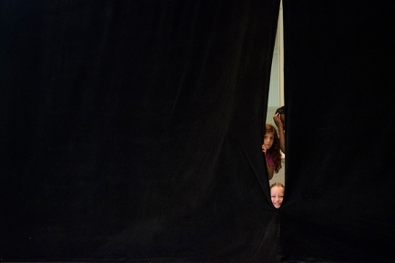 "Group 2 Boys and Girls peek through the curtain during their performance ""Grease"" at the Air Band competition. (Photo by Joshua Boucher)"