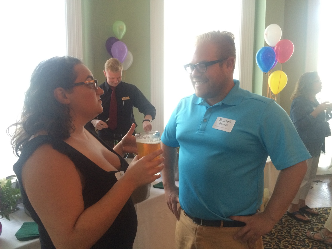 NOW Generation Advisory Council members Amy Schiller and Russell Bermel converse at a reception Wednesday honoring Chautauquans who serve in voluntary roles to support the Institution's mission. (Provided photo)