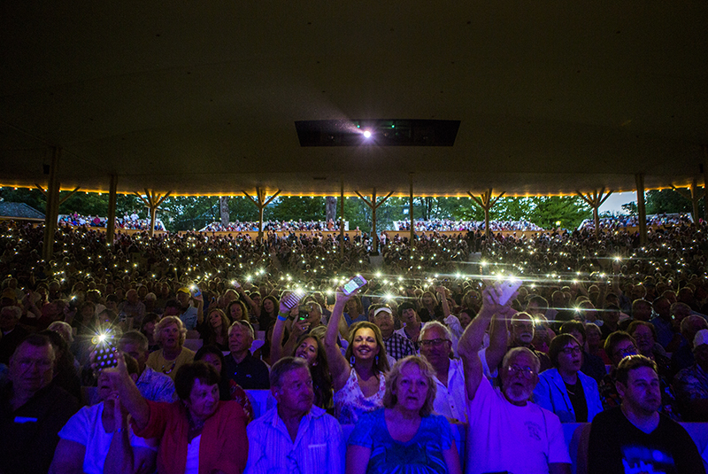 "Amphitheater Audience members raise their cellphone flashlights during ""Surfer Girl."""