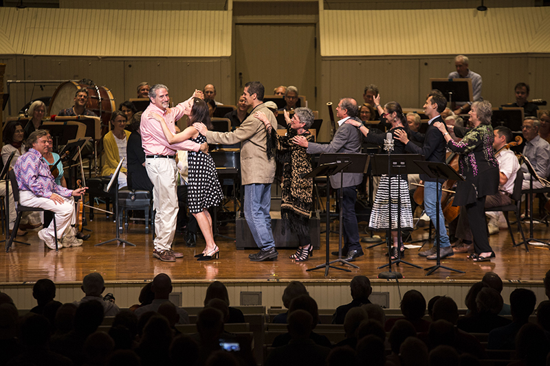 Chautauqua Opera Company faculty sing to departing General and Artistic Director Jay Lesenger during the annual Opera Pops Concert Aug. 8 in the Amphitheater. The Young Artists, with the Chautauqua Symphony Orchestra under the direction of guest conductor Stuart Chafetz, paid tribute to Lesenger and his career during the concert. (Bria Granville   Staff Photographer)