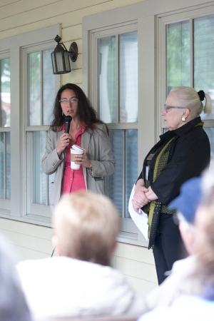 Deborah Sunya Moore, associate director of programming, and Sherra Babcock, vice president and Emily and Richard Smucker Chair for Education, speak at Wednesday morning's Trustees Porch Discussion on the Hultquist Center porch. (Saalik Khan   Staff Photographer)