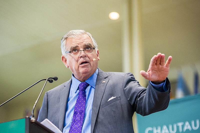 Ray LaHood, former secretary of the U.S. Department of Transportation, speaks about improving public transportation to build livable communities during the Friday morning lecture in the Amphitheater. (Ruby Wallau | Staff Photographer)
