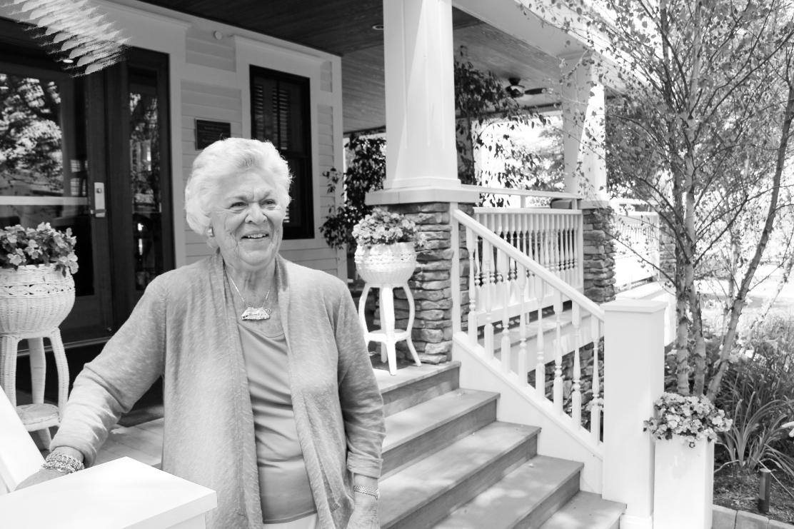 At left, the newly renovated Hagen-Wensley House, opened in 2011. At right, Susan Hirt Hagen stands on the porch of the Hagen-Wensley, the home for program guests of Chautauqua Institution. Hagen funded the reconstruction of the building in 2010. She passed away June 13; a memorial service will be held at 1 p.m. Saturday in the Hall of Philosophy.  (file photo)